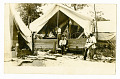 View Men gathered outside tent digital asset: Men gathered outside tent
