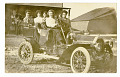 View Four women, two children and a dog seated in a car digital asset: Four women, two children and a dog seated in a car