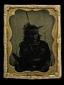 View Ambrotype of Mea-to-sa-bi-tchi-a, or Smutty Bear digital asset: Ambrotype, portrait of American Indian man in native dress with beads & feathered headress, 'Mea-to-sa-bi-tchi-a, or Smutty Bear'