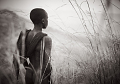 View Drew Doggett Photographs digital asset: Untitled 1, Suri Boy Surveying his Cattle, Suri Village, Omo Valley, Ethiopia