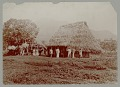 View Group in Native Dress Outside Thatch-Roof Huts n.d digital asset number 1