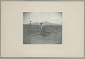 View Woman in Native Dress, Carrying Goods, and with Dog by Railroad Tracks? n.d digital asset number 0