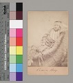 View Portrait of Tar-Lo, Boy, with Face Paint, Hairpipe Breastplate, and in Partial Native Dress, Lying on Animal Skin Near Fort Sill. 1867-75 digital asset number 0