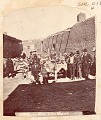 View Group of Non-Native Men, Boys and Native or Mexican ? Men with Group of Saddled Burros Outside Adobe Buildings n.d digital asset number 0
