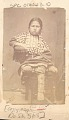 View Portrait of Young Girl in Native Dress, Including Elk-Tooth Shirt, Dentalium Shell Earrings and Breastplate digital asset: Portrait of Young Girl in Native Dress, Including Elk-Tooth Shirt, Dentalium Shell Earrings and Breastplate