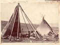 View Group of Women in Native Dress, Inside Partially Covered Tipi; Cooking Tripod, Metal Pot and Sack of Flour? or Grain? Inside Tipi; Other Tipi Nearby Near Yellowstone River digital asset: Group of Women in Native Dress, Inside Partially Covered Tipi; Cooking Tripod, Metal Pot and Sack of Flour? or Grain? Inside Tipi; Other Tipi Nearby Near Yellowstone River.