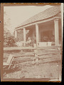 View Possibly family of Benjamin Paul on porch of house. Elderly woman sitting is Clara Dardin. n.d digital asset number 1