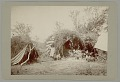 View Shaman and Family in Native Dress with Two Wickiups, Metal Cookware, Basket Jug and Blanket digital asset: Shaman and Family in Native Dress with Two Wickiups, Metal Cookware, Basket Jug and Blanket