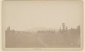View View of Ranch Showing Wood Buildings, Silo, Wood Fences, and Cattle; Mountains in Distance 1883 digital asset number 1