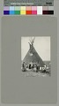 View Three Atsina men (one with gun) and woman outside painted tipi Copyright 22 MAR 1907 digital asset number 1