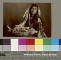 View Woman with blanket, wearing corn husks in her hair and holding basket containing corn and apples Copyright 10 FEB 1906 digital asset number 3