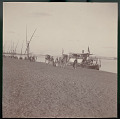 View Group in Costume, Leading Camel Caravan Along Shore Beside Feluccas (Sailboat); Passenger Boat with American Flag Nearby On Shore 1904 digital asset number 1