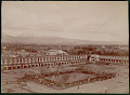 View View of Building Complex (Tapkaneh?) of Old Capital City of Rey; Group in Costume in Plaza with Cannons Near Landscaped Pool In Center; Mountains Beyond 1890 digital asset number 0