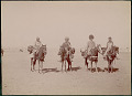 View Four Men in Costume, Leaders of Caravan, on Horseback; Cannon And Palace in Background 1896 digital asset number 0