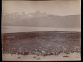 View Elevated view of town and port with snow-covered mountains and islands in distance 1892 digital asset number 0