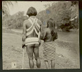 View Choco Man in Ceremonial Costume and Woman in Costume at River's Edge (Back View) 1923 digital asset number 0
