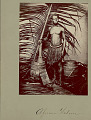 View Portrait of Male Laborer Wearing African Grass Skirt and With Paddle?, Wood Barrels, and Sanza (African Musical Instrument) digital asset: Portrait of Male Laborer Wearing African Grass Skirt and With Paddle?, Wood Barrels, and Sanza (African Musical Instrument)