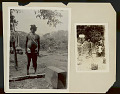 View Man Wearing Silver Ear Plugs and in Ceremonial Costume Near Painted Notched Post and Wood Crate 1923 digital asset number 0