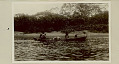 View Choco Man in Costume with Woman and Young Child in Dugout Canoe On River 1923 digital asset number 0