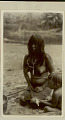 View Choco Woman Wearing Face Paint and in Costume and with Young Child Holding Doll at River's Edge 1923 digital asset number 0