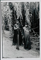 View Young Amahuaca? Men Wearing Face Paint and Holding Bow and Arrows, With Young Woman; Both in Costume with Bead Sashes and Necklaces JUL 1910 digital asset number 1