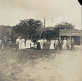View Native and Non-Native Group Including Helen Hamilton Gardener and Mr and Mrs Palacio Outside Automobile Repair Shop Beside Hotel 1909 digital asset number 1