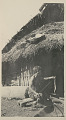 View Old Woman in Costume, Spinning Outside Pole House with Thatch Roof n.d digital asset number 1