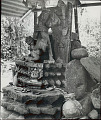 View Ancient Statue of Hindu Goddess Durga with Offerings of Leaves, Coins, Pottery, Etc Made by Local Villagers 1954 digital asset number 0