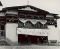 View Stone and Wood Gompa (Sacred Library) with Curtain Over Entrance Portraying Eight Auspicious Emblems of Buddhism 1954 digital asset number 0