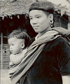 View Woman Wearing Velvet Jacket from Assam Plains, Earrings And Necklace and Carrying Infant in Sling 1954 digital asset number 0