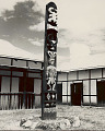View Painted Wood Pole Carved with Chang Symbols Outside Tuensang Craft Center Built of Plaster-Covered Poles and Mud with Teak Timbers and Corrugated Metal Roof to Withstand Earthquakes 1954 digital asset number 1