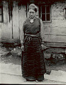 View Young Woman in Costume Outside Plank House 1954 digital asset number 0