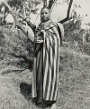 View Woman in Costume with Traditional Hand Woven Cloak and Basket 1954 digital asset number 1