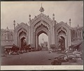 View Gateway Hussainnabad with group of East Indians by thatch shelters with food and goods nearby 1863 digital asset number 3