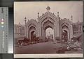View Gateway Hussainnabad with group of East Indians by thatch shelters with food and goods nearby 1863 digital asset number 2