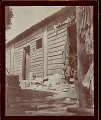 View Young Boy? in Costume Outside Plank Firecracker Factory With Tile Roof 1896 digital asset number 1