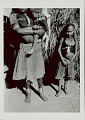 View Two Young Girls and Infant in Costume and with Ornaments Near Brush Structure 1965 digital asset number 0