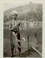 View Man in Costume with Fish and Disassembled Fish Net? On Riverbank digital asset: Man in Costume with Fish and Disassembled Fish Net? On Riverbank