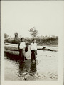 View Two Women in Costume Near Log Structure in River digital asset: Two Women in Costume Near Log Structure in River