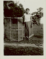 View Woman in Costume with Bamboo Fish Trap? digital asset: Woman in Costume with Bamboo Fish Trap?