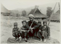 View Man Smoking Pipe with Silver Stem and with Four Boys in Costume and Ornaments in Village 1931 digital asset number 1