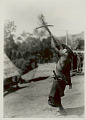 View Man in Costume with Knife in Woven Bamboo Knife Sheath And Aimimg Crossbow 1931 digital asset number 1