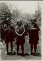 View Three Women in Costume with Headdresses, Woven Bamboo Knife Sheath, and Burden Bags 1931 digital asset number 1