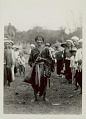 View Man with Pipe and Two Cloth Bags, One Beaded; Group Nearby; All in Costume 1931 digital asset number 1