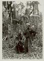View Two Men in Costume and with Homemade Muskets, Net Bag, and Knife in Woven Bamboo Sheath 1931 digital asset number 1
