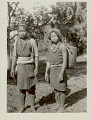 View Two Women in Costume and with Ornaments, Carrying Burden Baskets with Tumplines 1931 digital asset number 1