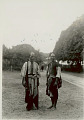 View Two Men in Costume and with Cloth Bags, One Wearing Large Silver? Earrings 1931 digital asset number 1