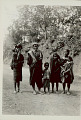 View Family Group in Costume; Woman Carrying Cloth Bag on Head On Road 1931 digital asset number 0