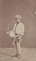 View Portrait of Boy in House Servant Costume, Holding Kerosene Lamp and Ceramic Jug n.d digital asset number 0