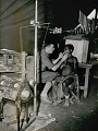 View Dentist, David Cameron, Non-Native, Adjusting Dental Film In Mouth of Woman Wearing Grass Skirt; Dental Equipment In Foreground 1947 digital asset number 1
